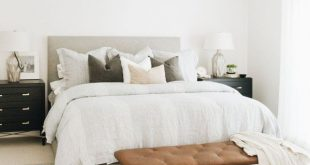 Modern farmhouse bedroom, white walls and neutral decor makes this a very relaxi...